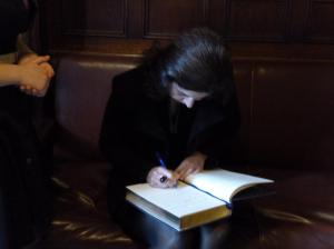 Special Representative Pandith signing the Oxford Union book.